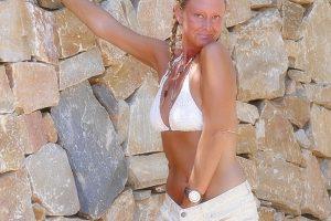 Natalie K flashing outdoors in a bikini