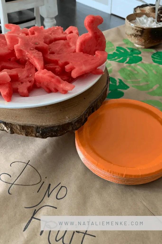 Volcano Birthday Party food including dinosaur-shaped watermelon at www.nataliemenke.com