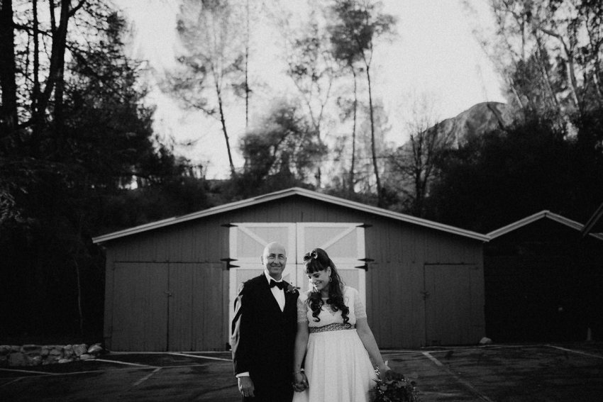 Beautiful Malibu Wedding at Malibou Lodge, California. Bride in 50's style dress, victory rolls wedding hair and customised converse, Italian groom in classic tux. Intimate and relaxed outdoor ceremony with photographs along Mulholland Highway. Purple Smoke bomb wedding photographs. Photographed by Natalie Pluck. To see more from this wedding click here: http://www.nataliepluck.com/beautiful-malibu-wedding/ #lawedding #malibuwedding #losangelesweddingphotographer #beautifulmalibuwedding #lakemalibou #santamonicawedding #50sweddinginspiration #50sbrideinspiration #weddingconverse #weddingtuxinspiration #relaxedwedding #smokebombphotos #smokebombwedding #weddingsmokebombs #purplesmokebombwedding #purpleenolagaye