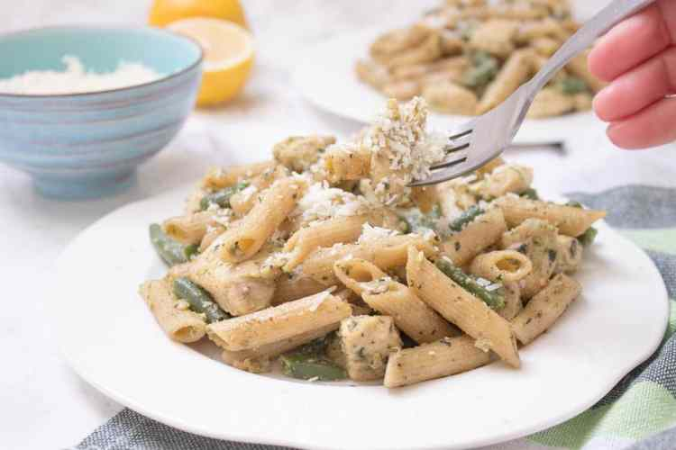 Easy Basil Pesto Chicken Pasta is the perfect HEALTHY weeknight meal for busy days. Packed with flavors and ready under 20 minutes! CLICK to read the recipe or PIN for later. [natalieshealth.com] #recipe #healthy #easy #family #chicken #low-fat #pasta #pesto
