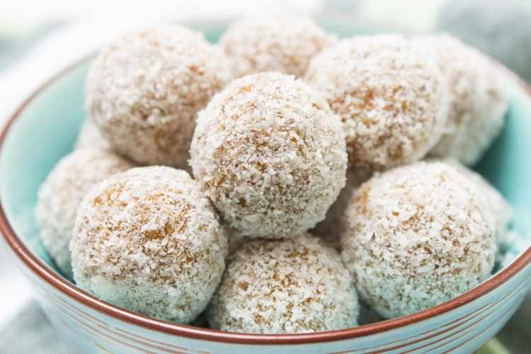 Raw no-bake Carrot Cake Energy Balls made with all HEALTHY ingredients. These yummy bites are refined sugar-free, gluten-free and vegan. Perfect snack, a post-workout snack or simple dessert. | natalieshealth.com | #vegan #glutenfree #sugarfree #Easter #healthy #easy #whole30