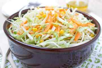 Cabbage Carrot Slaw made with FRESH veggies - green cabbage, carrots, celeriac root and sweet corn is the ultimate summer salad. Crunchy, sweet and tangy with the touch of ginger freshness, this salad is both delicious and ridiculously simple! #healthy #coleslaw #salad #bbq #summer #spring #vegan #glutenfree #vegetarian | natalieshealth.com