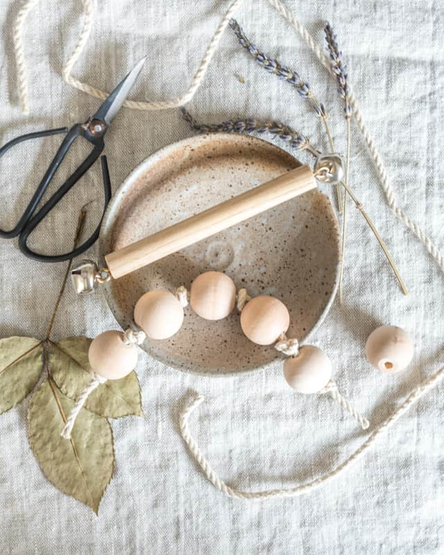 diy natural wood toys - wood bead clutching toy and bell rattle