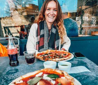 Natasha enjoying a pizza - square