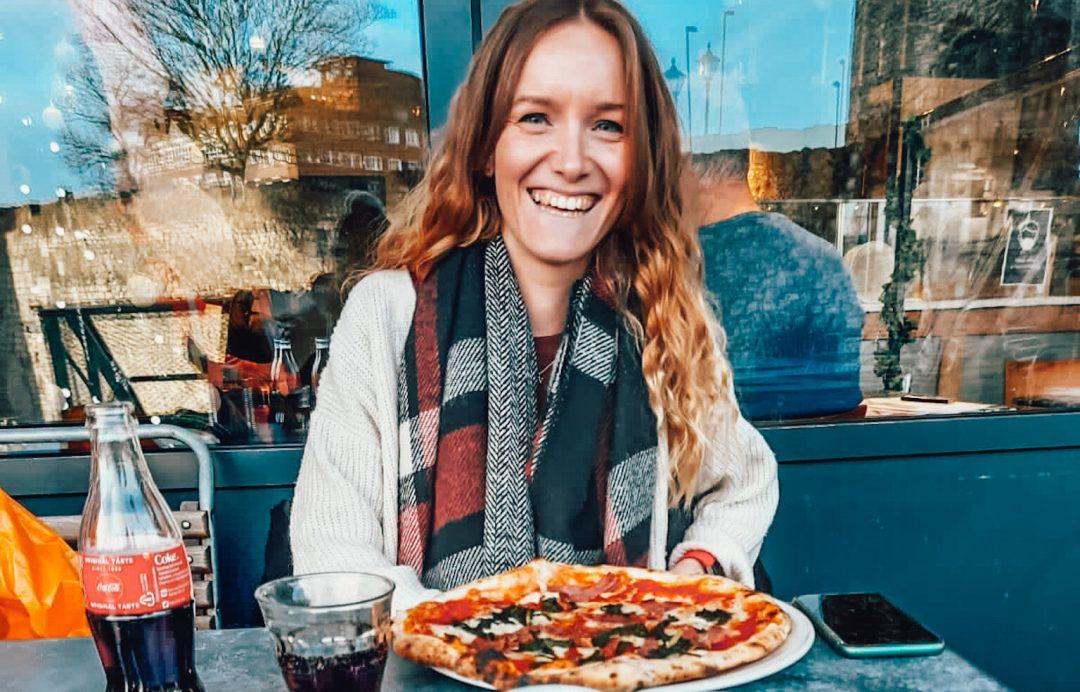 Natasha enjoying a pizza
