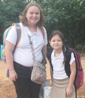 Caitlin and Kimee Moak, daughters of Patty and Josh Moak, are up, smiling and ready to enter the sixth and fourth grade at Marthaville Elem/Jr. High school.