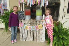 Brinlee and Cambria Berry sold original and strawberry lemonade to thirsty passers-by on Front Street.