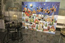 Paying customers can enter into an advent calendar prize drawing. Each prize is revealed through these 24 little doors.