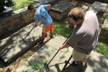 """Tyler Magnano - """"Cleaning up the cemetery is a great way to honor and respect the lives of those buried here and their families."""" Thomas Young - """"I've done a lot of community service with my church, so I figured, why stop now?"""""""