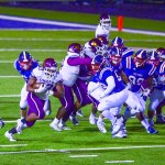NCHS-Derrick Payne finds a hole picking up 4 yards on the run