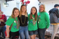 At a reception after the parade were, from left, Becca Autry, Katie McCauslin, Lesley Tucker and Becky Wolff.