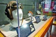 The exhibit displays artifacts such as the flight hat, goggles and patch from VMF-214 of Henry Bourgeois of New Orleans.