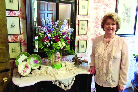 Kay Foshee's floral arrangement included ruby snapdragons, green hydrangea, blue delphinium, coffee beans, cluster roses and green wreath.