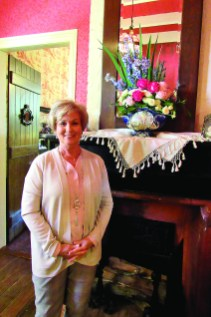 Sandra McCullen used garden and Valentine's Day roses, blue delphinium and thistle in her floral arrangement.