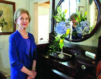 Sarah Katherine Ahrens placed blue hydrangea, yellow tulips, ruscus in her mother's candelabra.