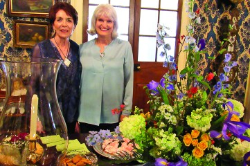 Sharon Gahagan and Sarah Luster created the floral arrangement that served as the centerpiece for the appetizer table. It consisted of white hydrangeas, yellow roses, iris, dogwood, fern leaves, mint, rosemary, delphinium and monte christo.