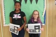 Deanna Fowler and Lilly Westfall in the sixth-seventh grade class show their drawings on animals that thrive in the day or night time, and above or under ground, in the desert.
