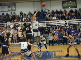 Thomas Howell takes command of the tip off. By Trent Friedel