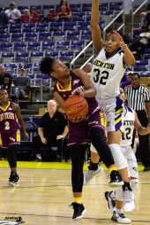 Tykeria Sowell absorbs the contact as she goes up for a layup attempt. By LeRon Massey