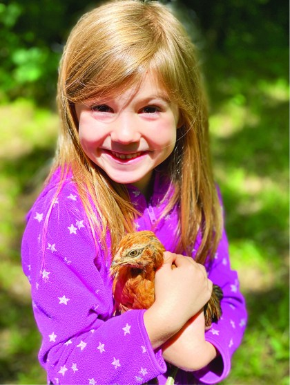 Callie Hannegan with her pet chicken Ariel. She's the most spoiled chicken I know!