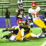 NCHS-#2 runs over a LCCP defender for the first down