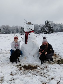 Callie and her sister Katherine Grant, with their big snowman.