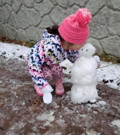 Three year Bree Martinez of Many, on her making of her little snowman. After the finished product, Bree Martinez had to give her snowman a little kiss and a hug.