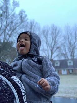 Lexie Seawood enjoying her first snow day