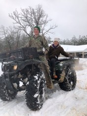 Cash Mitchell and another cousin RayleAnn Hays doing a little 4 wheeler riding in the snow.