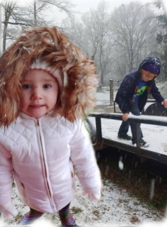 Rylee Mitchell and Kaiden Ensinger having fun at NeNe and Poppy D's house in the snow.