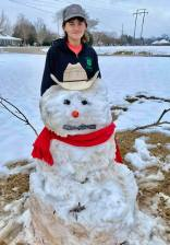 Tatum Roberts with his cowboy snowman