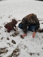 The first making of a snowman, Chase Hershberger and Madi Meshell of Many, start with the project of their snowman.