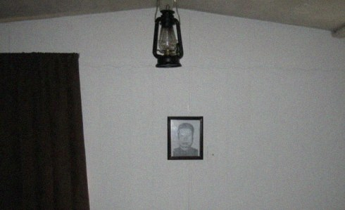 Picture of Pol Pot on the wall inside mobile home on secluded South Carolina property of the Rural People's Party (RPP) headquarters
