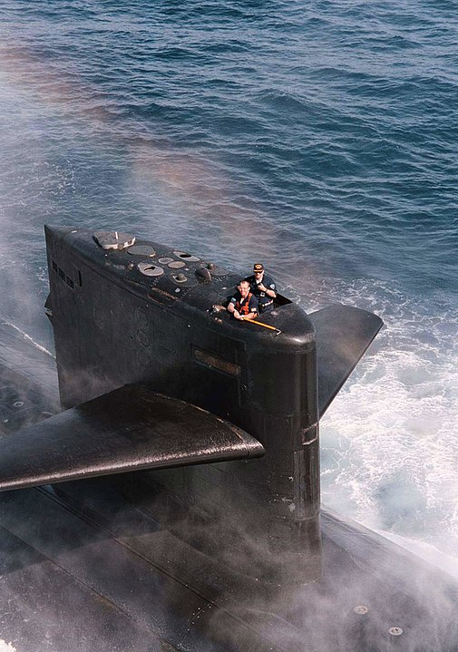 Picture of author on USS Baltimore submarine. Submariners work at cross qualifying something that should be applied to marketing teams