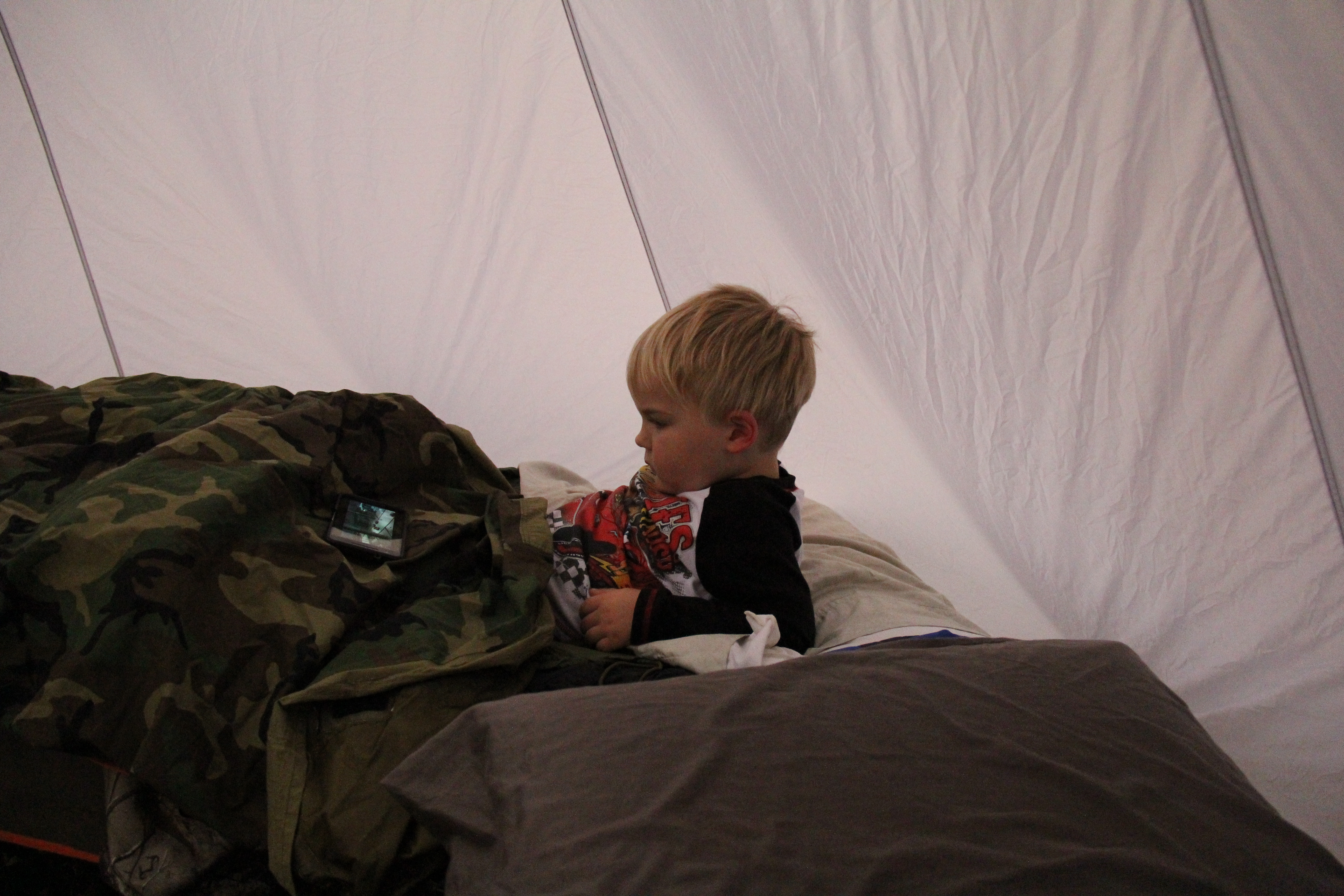 "Jackson Watching ""Cars 3"" inside of his sleeping bag, in the Seek Outside 8P tent"