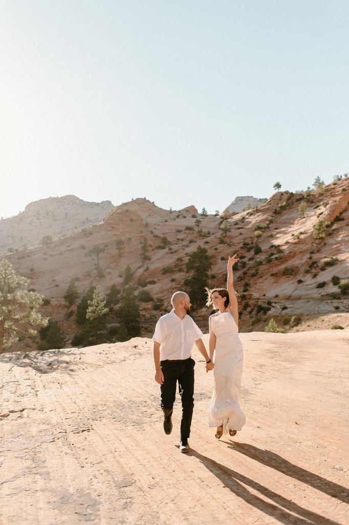 Couple jumps together at Zion National Park Elopement