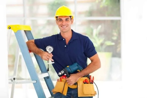 Worker with toolbelt, hard hat, step ladder - installer