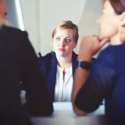 woman consultant in meeting with two other women