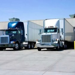 two 18 wheeler trucks