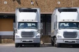 Two 18 wheeler trucks at loading docks