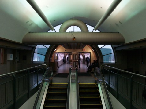 Escalators connect the entrance of the the Charles Street Terminal to the elevated pedestrian walkways.