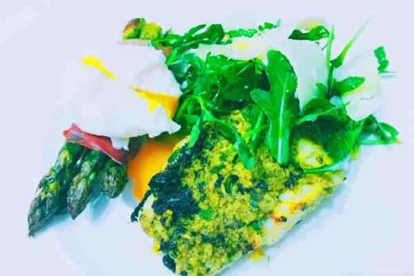 Pesto cod with asparagus in Parma ham national dish Italy