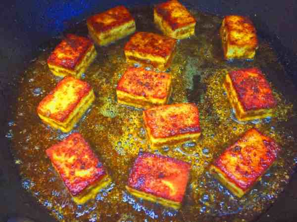 Gently fry the paneer on each side to get a golden colour Indian food from National Dish