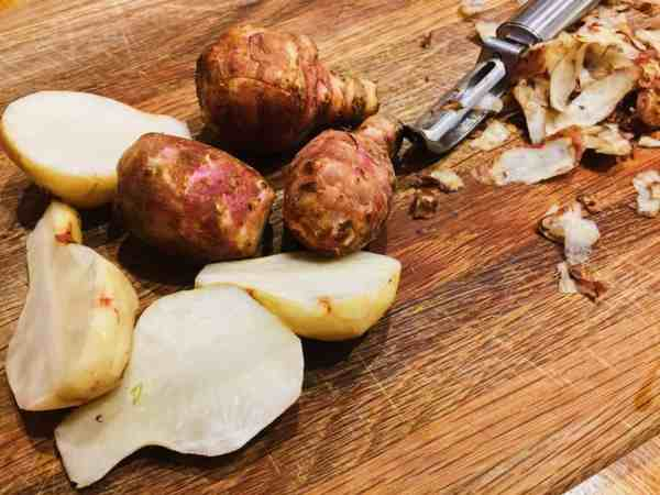 Peel and slice in half Fartichokes for roasting | National Dish
