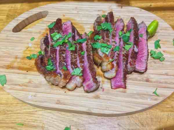 Slice the beef, squeeze lime juice and sprinkle coriander over it