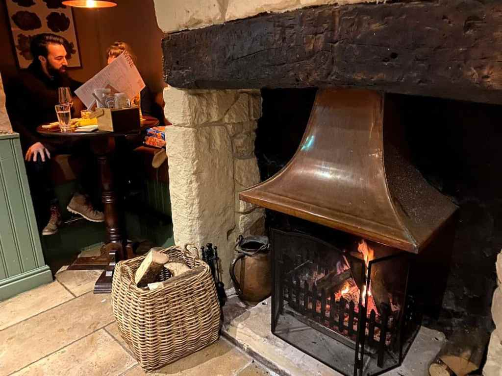 The cosy lovers table at the bar in the Kings Arms in Prestbury, Cheltenham