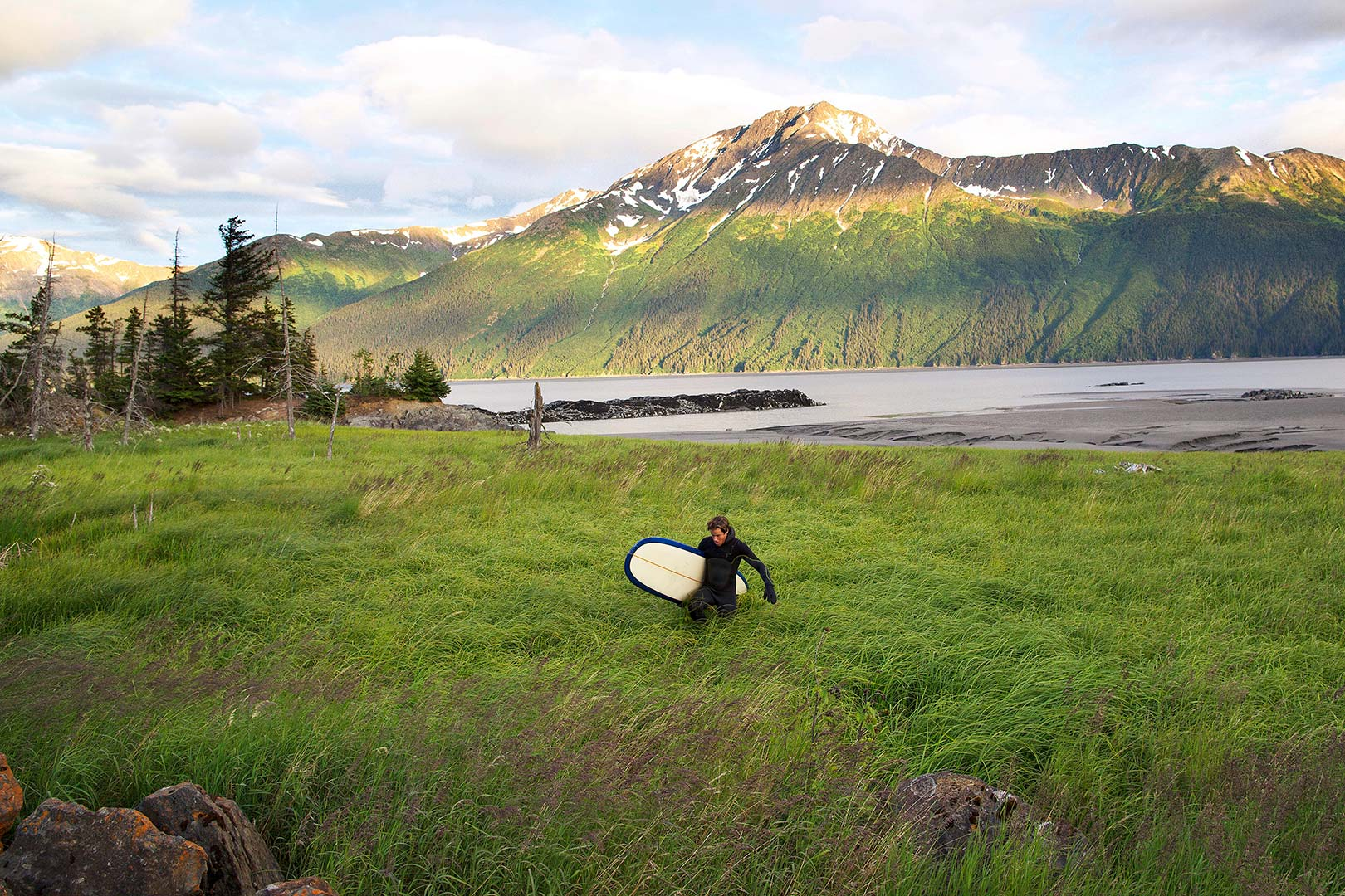 Picture of a surfer near Turnagain Arm, Anchorage, Alaska