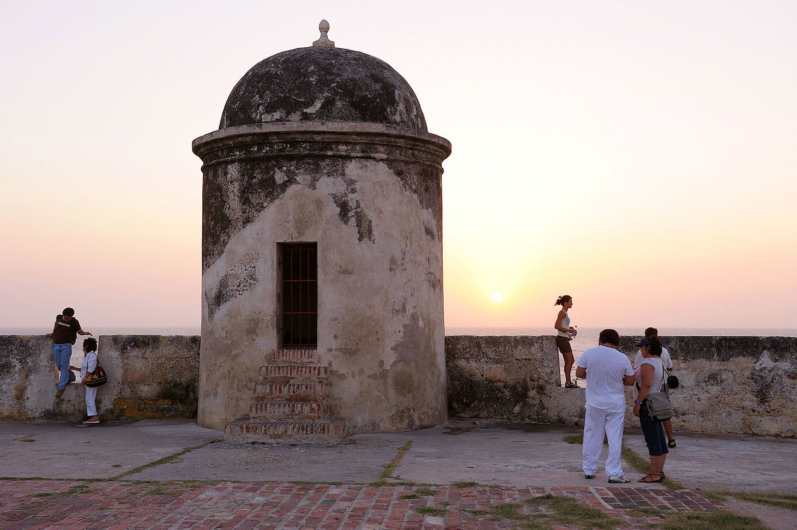 Picture of people near the city walls at sunset, Cartagena, Colombia