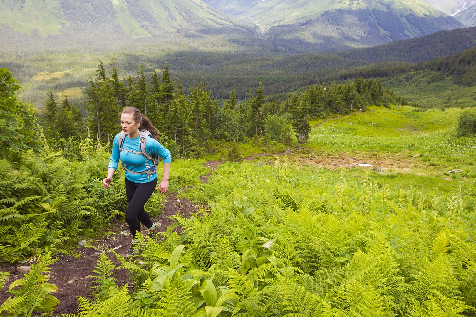 Picture of a woman running in the Girdwood Valley, Alaska