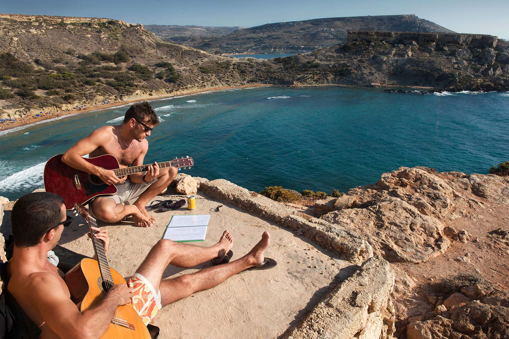 Picture of young men playing guitar above the Grand Harbour, Malta